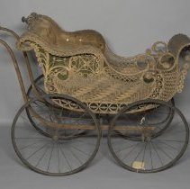 Image of Wicker baby carraige with padded seat; c.1910