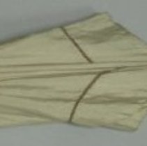 Image of Beige cotton parasol with wooden handle.