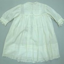 Image of Infant's gown with lace edged neck, cuffs, and hem; unknown date.