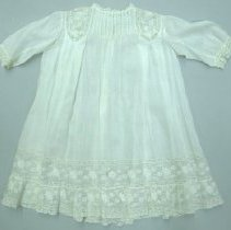 Image of Infant's gown with lace neck, cuffs, hem; lace insets in shoulders; c.1900