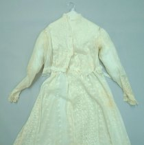 Image of White two-piece dress, with floral pattern embroidery; c.1910.