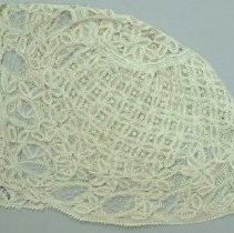 Image of Beige, tatted lace baby cap, pattern made up of flower designs.