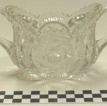 Image of Pressed glass sugar bowl, starburst design, irregularly cut top edge.
