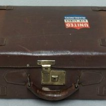 Image of Suitcase; brown leather suitcase with United Air Lines decal; c.1950