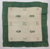 Image of Square doily with green border and abstract designs in center; 1920.
