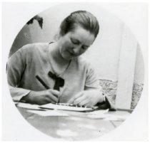 Image of Hilma Berglund writing in her diary, 1922