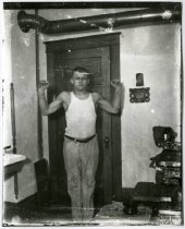 Image of Muscle man, Akeley MN 1910?