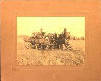Image of Image of threshing machine and crew, undated