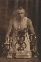 Image of Fritz Carlsen with trophies and medals