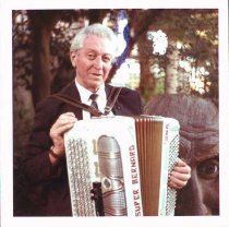Image of Emil playing an accordion at one of his openings, San Francisco, undated