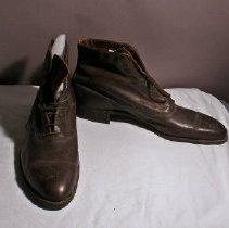Image of Pair of men's oxford shoes in dark brown leather. Upper comes over ankle.                                                                                                                                                                            - Shoe