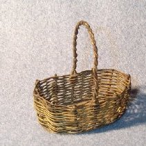 Image of Oval, brass, woven wire basket with solid brass bottom, twisted handle                                                                                                                                                                       - basket