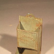Image of Green-painted, rectangular, hanging 3.13  matchbox holder with bottom slot  for accesssibility to matches                                                                                                                                    - safe, match