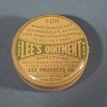 Image of Round metal can with push-on lid; green printing on yellow-tan background                                                                                                                                                                    - box