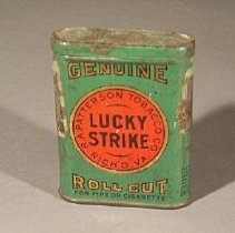 Image of Rectangular tin with rounded sides and hinged lid; gold and black lettering on green and red background                                                                                                                                      - box, tobacco