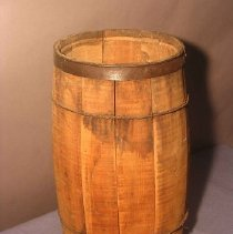 Image of Wooden keg with 1.13 wide iron hoops top and bottom; wire hoops around keg.                                                                                                                                                                  - keg