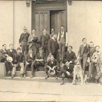 Image of Unidentified group of  (17) men and one dog on front steps of a building.                                                                                                                                                                                       - 1994.064.0009f