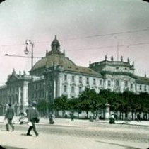 Image of Wide street with large government building