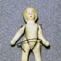 Image of Small bisque doll - moveable arms, painted face and hair..possible from Brownells Dry goods on Front Street - Doll