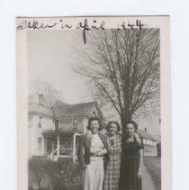 """Image of Photograph (black and white) of three woman standing in a group on a sidewalk. Written on edges of front of photo is """"Taken in April 1944 - Aren't we sweet tho?"""". The woman in the middle who appears older than the other two women is probably Fannie Cohen, mother of Samuel Cohen. The other women could possibly be sisters of Samuel Cohen. On the back of the photo is the series mark """"33"""" - 2011.036.0022"""
