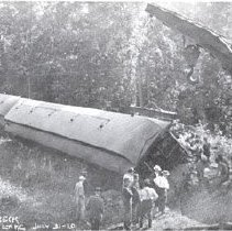 Image of Modern copy of photograph of D&H Railroad train wreck at Ballston Lake July 31, 1910.  Shows passenger cars on sides, crane.                                                                                                                                   - 1975.048.0002