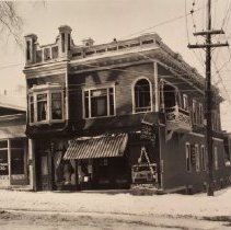 Image of View of J.S. Wooley's photograhic studio and Kodak Shop on corner of Milton Ave. and Washington Street, Ballston Spa.  Next door at 71 Milton Ave is Groat & Hickey Baths.  See also 77.037.224                                                                - 1980.003.0561