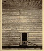Image of Window with Round Hole and Brick Walkway, Billings, Montana