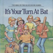 """Image of PZ7.A26924 It 1988 - Book: """"It's Your Turn At Bat"""" Aiello and Shulman. Kids on the Block - Cerebral Palsy. By Barbara Aiello and Jeffrey Shulman.  Illustrated by Loel Barr. On back, """"World Famous sports editor and champion wheelchair driver ' - that's Mark Riley. Born with Cerebral palsy, Mark discovers that strength must come from within when it's time for a big league play. It's Batter up ' for the one and only Mark Riley!"""""""