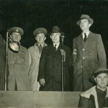 Image of A group of six men at night - 1942 C