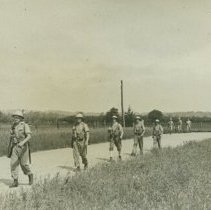 Image of Soldiers marching down a dirt road - 1942 C