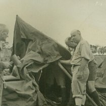 Image of Soldiers setting up a tent - 1942 C