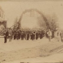 Image of Loyal Orange Lodge Parade, 1877 - Parade in front of the Railway Station.  Haynes Station Hotel at left (demolished circa 1930).