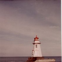 Image of The lighthouse, adrift, pier destroyed by storm