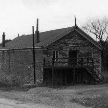 Image of MacDougald's Warehouse - Granary - MacDougald's Warehouse was the only stone building located on Robinson Street. It was at the foot of the street near the river. It belonged to Peter Archibald MacDougald from 1867 to 1887. It is now located at 105 Robinson Street and is the National Bank Financial.