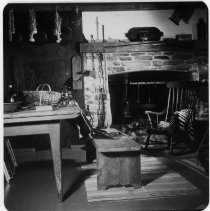 Image of Interior of Thomas House - The interior of the Thomas House after it was moved to Front Street in 1955. Picture of the fireplace and kitchen table. See also 1950.3.204.