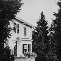 """Image of Balsam Lawn - This house was located on the corner of Balsam Road (now Balsam Drive) and Colborne Street (now Lakeshore Road). It was built by William Wass in the 1870's. It was the residence of Miss R.A. Wass and later C.W. Freer. C.W. Freer named the house """"Balsam Lawn"""". It is now located at 457 Lakeshore Road East."""