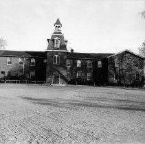 Image of Oakville Common School - The building of the Central School, built in 1850 on Navy Street. It was built out of necessity once there were too many students at the original building of the Common School. It was open for 12 months of the year, had 190 students and 1 teacher. In 1874 the bell tower, library and north wing were added, and they started the Grammar School in the west wing. In 1881 the east wing was added giving an entrace on Navy Street. In 1900 the west wing was extended. In 1910 the high school was built on Reynolds Street which meant that the common school was entirely a public school and was then called the Central School. It was eventually demolished in 1960.