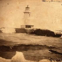 Image of Lighthouse after a Storm - The lighthouse just after a storm at the Oakville Pier. It now stands on the west bank of the Harbour.