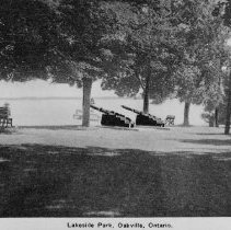 Image of Lakeside Park - View of Lakeside Park showing 2 solid iron cannons that were given to a member of the Chisholm family after the Boer War. They were both melted down in World War II. Photo used on postcards.