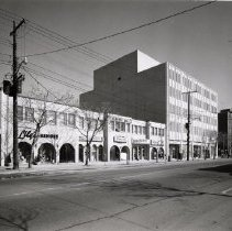 Image of North side of Lakeshore Road East - The north side of Lakeshore Road East between Allan Street and Reynolds Street. The large building on the corner is the previous Chamber of Commerce Building.