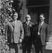Image of Dr. W.M. Wilkinson (far left) with two unidentified men - The Wilkinsons lived on the north-east corner of Trafalgar Road and Palmero Avenue, in Oakville.