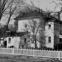 Image of Unidentified House - Large two storey white house, with outside stairs to the second floor. Exact location unknown.