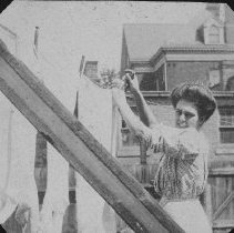 Image of Unidentified woman hanging laundry