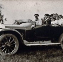 "Image of Six unidentified people in an automobile - Possibly Callon family members. Back of the photo reads: "" This was used as backing for a framed picture of a team. Mrs. Patton's brother - worked at Hewson's."""