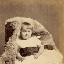 Image of Bessie B. Henelson - Photographed here as a young girl, probably taken in St. Catharines, ON.