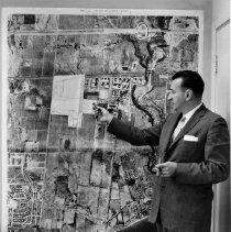 Image of Map of Land for Refinery - A photo of a Shell Canada employee (Cy Moro), showing a map of Oakville lands to be used for a new refinery.  Today, the refinery is now dismantled.