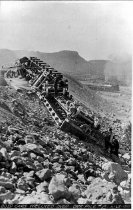 Image of 20 yd cars wrecked over ore pile
