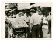 Image of Israelis Read News of Eichmann's Arrest