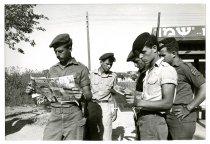 Image of Israeli Soldiers Reading Newspaper