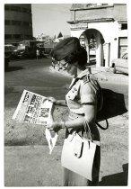 Image of Military Woman Reading Israeli Newspaper